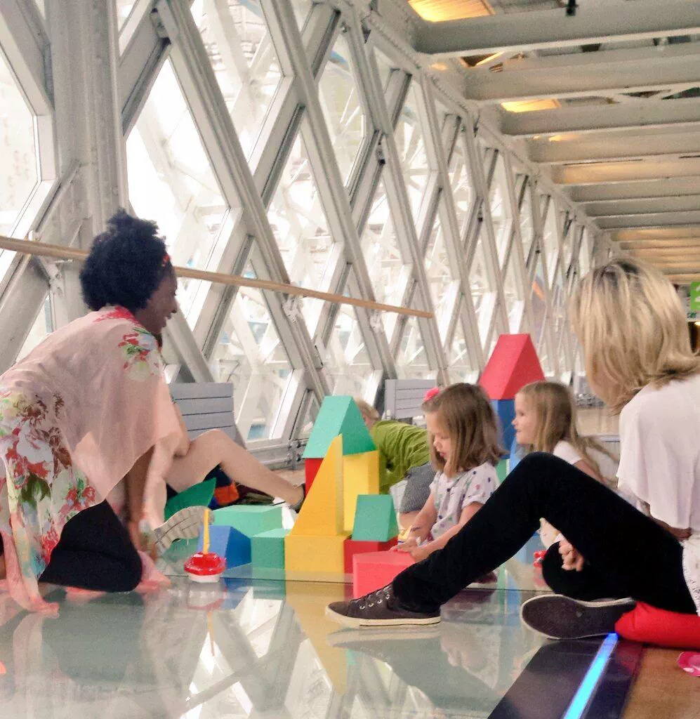 Professional Storyteller Wendy Shearer storytelling on theTower Bridge glass floor Walkway