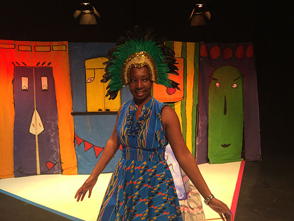 Wendy Shearer wearing a mask for Caribbean Storytelling